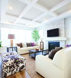Living room with white columns on the ceiling