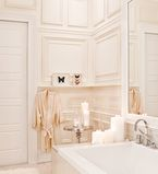 Bathroom with white paneling along the wall