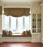 Large window bench with white moulding along the outside