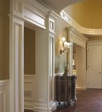 Foyer With white moulding along the entrance to other rooms