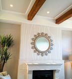 Fireplace on the wall with white moulding